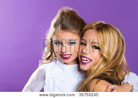 children two fashiondoll kid girls good friends with fashion makeup on purple