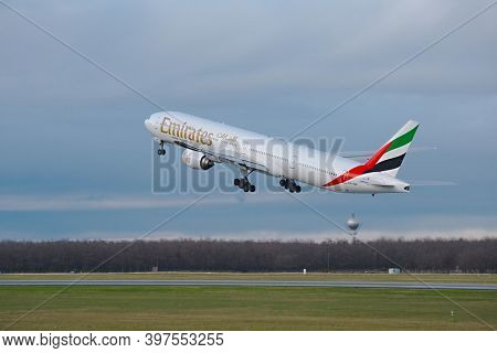 BUDAPEST, HUNGARY - DECEMBER 01, 2015: Emirates Boeing 777-300 taking off at Budapest Airport. This was the first ever Emirates flew the 777 to Budapest.