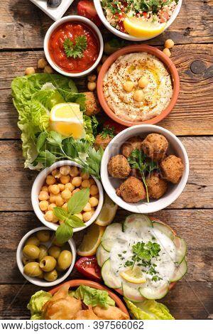 assortment of dish- hummus, falafel, pita bread, chickpea