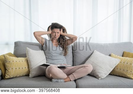 Young Girl Push Her Hands On Her Ears Trying To Not To Hear The Loud Noise From Neighbor Apartment I