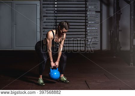 Young Sweaty Strong Muscular Fit Girl Holding Heavy Kettlebell With Her Hands Preparing For Swing Ha