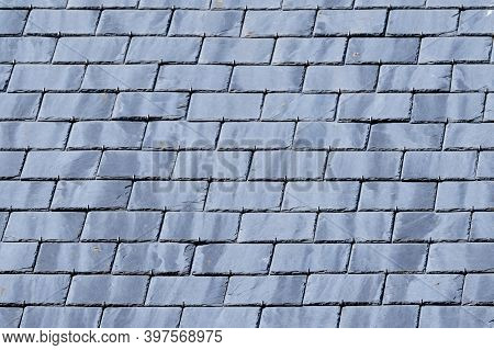 Gray Background Of Roof With Slate Tiles. Close-up And Full Screen