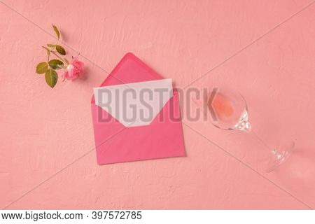 Romantic Card Or Invitation Mock Up, An Overhead Flat Lay Shot With A Pink Rose And A Glass Of Rose