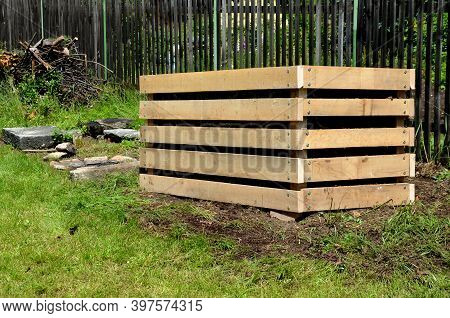 A Composter Made Of Natural Beech Prisms Built Horizontally With Black Foil Inside In A Meadow Near