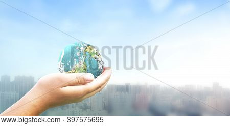 Human Hand Holding Earth Global Over Blurred  City Background. Elements Of This Image Furnished By N