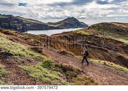 Girl Hiking Rocky Cliffs Clear Near Water Of Atlantic Ocean Bay Ponta De Sao Lourenco, The Island Of