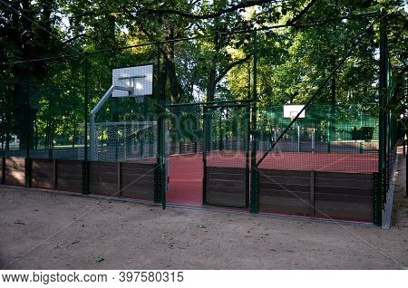 Public Multifunctional City Playground With Tartan Surface In The Park Is Used To Play Basketball Fo