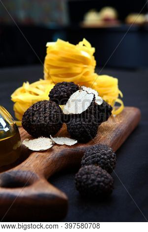 Black Truffle On A Wooden Board With Paste In The Form Of Nests. The Season Of Truffles. Natural Ant