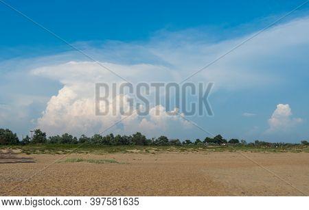 A Big And Fluffy Cumulonimbus Cloud In The Blue Sky