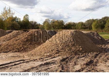 Mountain Of Sand At A Construction Site. Foundation Material. Soil Prepared To Strengthen The Soil.