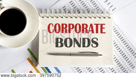 Corporate Bonds Text Written On Notebook With Pen And Chart