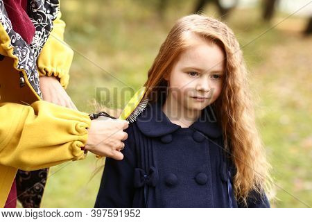 Mom Comb Irish Little Girl With Long Red Curly Hair Outdoor Close Up Photo