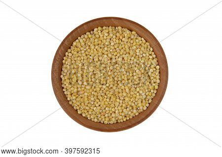 Millet In Wooden Bowl Isolated On White Background