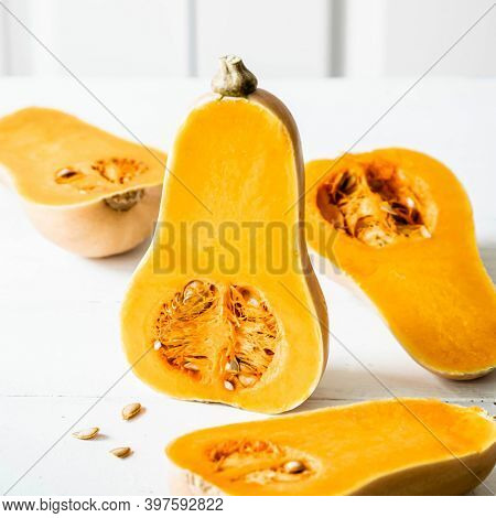 Butternut squash on white wooden table