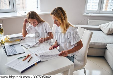 Parent Explaining The Subject To Her Teenage Daughter
