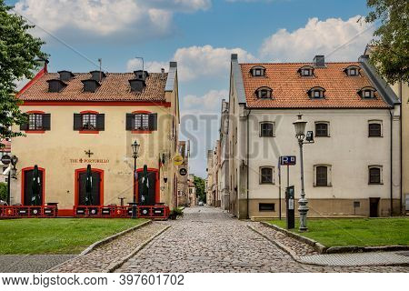 Klaipeda, Lithuania - July 10, 2020: Cobbled Street With Ornate Historical Buildings In The Center O