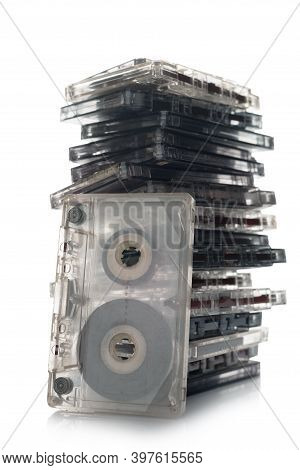 Collection Of Music Cassettes Stack Isolated On White Background.