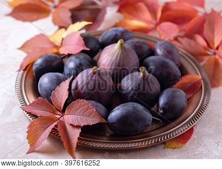 Ripe Plums And Figs On A Platter. Beautiful Food Photo. Picture. Cutting Board.