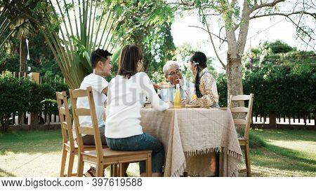 Happy Asian Family Having Festive Dinner, Multi Generation Family Enjoying Meal Together. People Hav