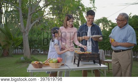 Asian Female Take Bbq Food Party Summer Grilling Meat. Happy Family Enjoying Meal Together. People H