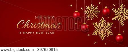 Christmas Red Background With Hanging Shining Golden Snowflakes And Balls. Merry Christmas Greeting