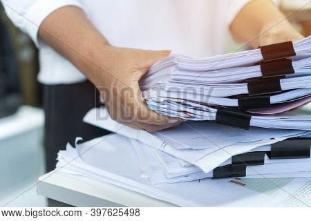 Employee Checking Business Unfinished Documents With Stacks Paper Files And Managing Document Achiev