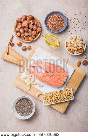 Omega 3 Food Sources And Omega 6 On Concrete Background, Omega-3, Top View Copy Space. Foods High In