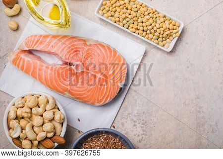 Omega 3 Food Sources And Omega 6 On Concrete Background, Top View Copy Space. Foods High In Fatty Ac