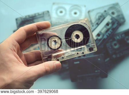 Hand Holds The Cassette. Retro Tape Cassette Music. Old Music.