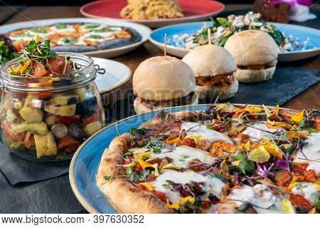 Authentic Italian Food Shows Large Table Full Of Plates Of Delicious Food And Ready To Eat.