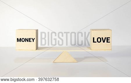 Weighing Between Love And Money On Seesaw. Weighing Between Family And Work On Seesaw.