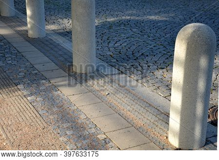 Road Bollard As A Barrier Against Cars Driving Into The Pedestrian Zone Or City Park Separated From