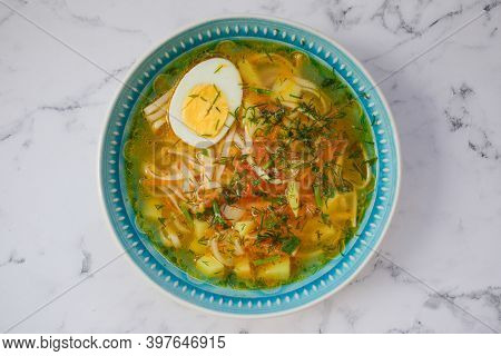 Chicken Noodle Soup With Egg, Top View, Udon Noodle Soup In A Blue Plate, Copy Of Space, Empty Space