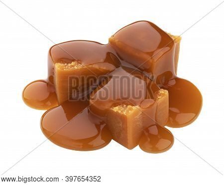 Caramel Candy With Caramel Sauce Isolated On White Background