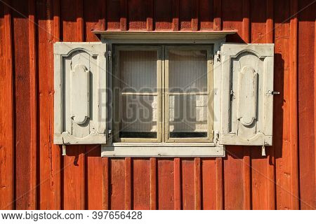 A Detail Of The Traditional Wooden House In Scandinavia With Its Red Colored Planks. The Color Is Ca