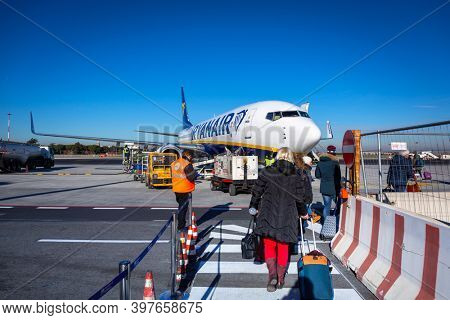 Rome Ciampino, Italy - January 12, 2019: People waiting for boarding to Ryanair plane on Ciampino Airport near Rome. Ryanair is the biggest low-cost airline company in Europe