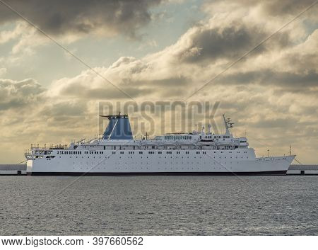 Passenger Ship Anchored In Port. Sea Transport For Cruise Travel