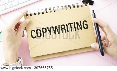 Businessman Holding A Card With Text Copywriting