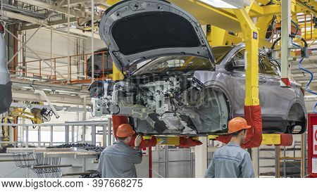 A Car Being Manufactured On An Assembly Line. Car Production Line. Industry Concept.