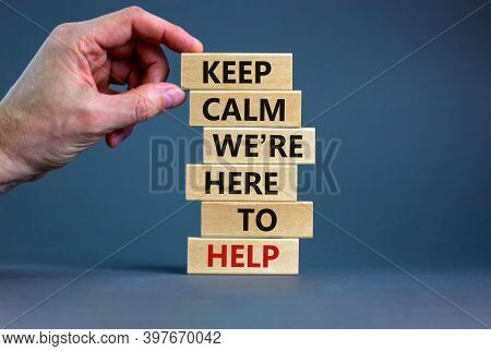 Here To Help Symbol. Male Hand Builds Stack From Blocks With Words 'keep Calm We Are Here To Help'.