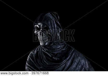 Grim reaper isolated on black background with clipping path
