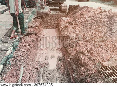 Plumber Dig Repair Main Plumbing  Pvc Pipe On Road
