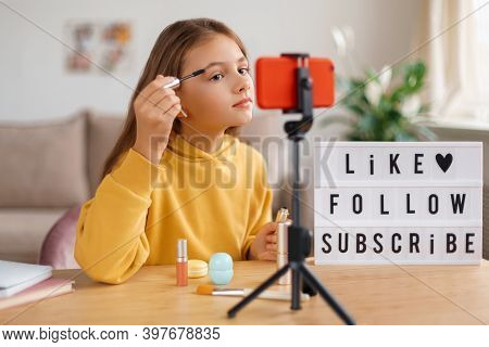 Young Fashionable Girl Blogger Filming Video For Her Followers And Subscribers About Makeup. Kid Inf