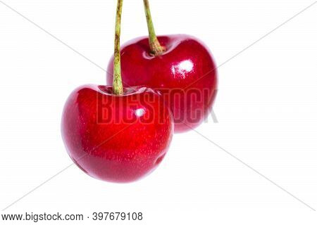 Two Organic Sweet Cherries Isolated On A White Background.