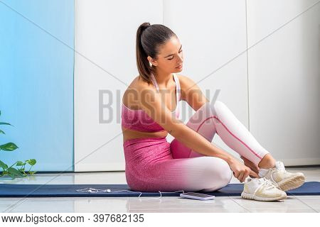 Close Up Portrait Of Young Woman Wearing Leotards Getting Ready For Fitness Workout At Home.