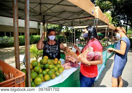 Mata De Sao Joao, Bahia, Brazil - September 30, 2020: People Are Seen Next To The Organic Products S