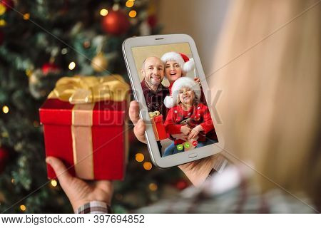 Children Congratulate Their Parents Via Video Conference And They Blow A Kiss. A Woman Holds A Digit