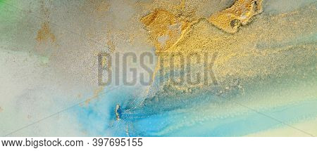 Art Abstract gold and blue painting blots horizontal background. Alcohol ink colors. Marble rust texture.