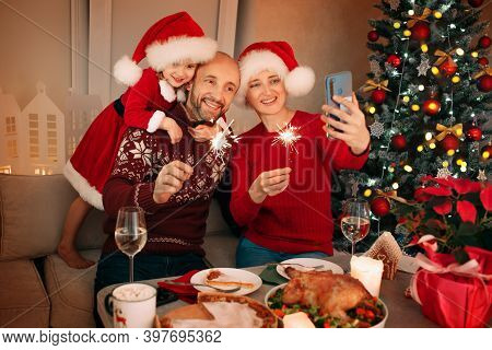 Merry Christmas, Family Having Dinner At Home. Video Greetings To His Parents. Celebration Of The Ho