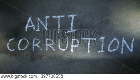 Anti Corruption Word Written On Blackboard With Chalk